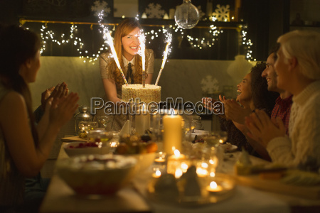 woman serving christmas cake with sparkler
