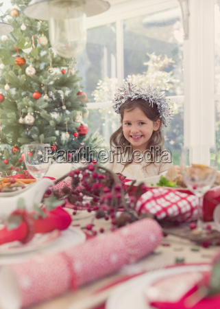 portrait smiling girl at christmas table