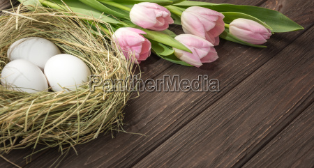 easter eggs in a straw nest