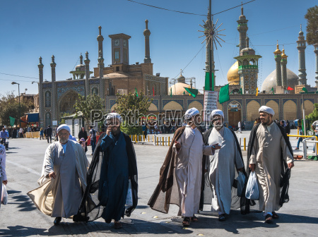 chatting mullahs against the minarets of