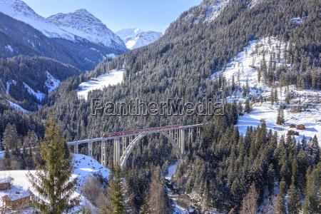 red train of rhaetian railway on