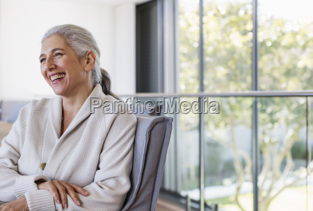 mature woman laughing looking away